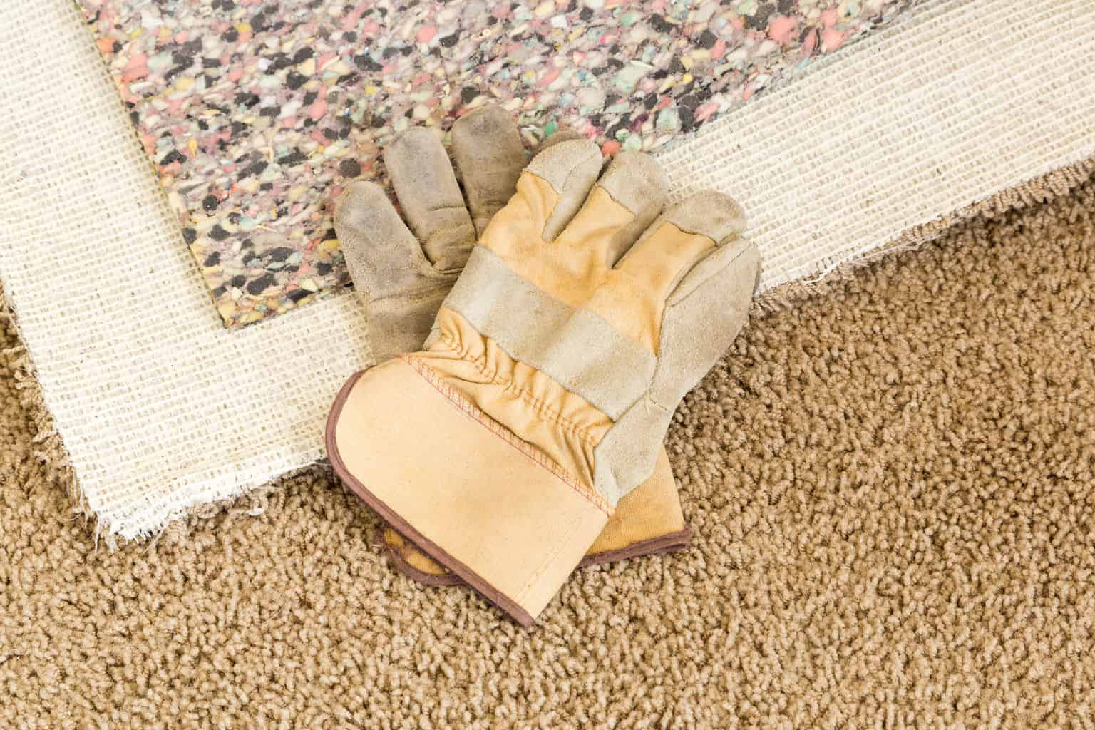 How to install carpet padding a complete guide step 3 lay carpet pad baanklon Images