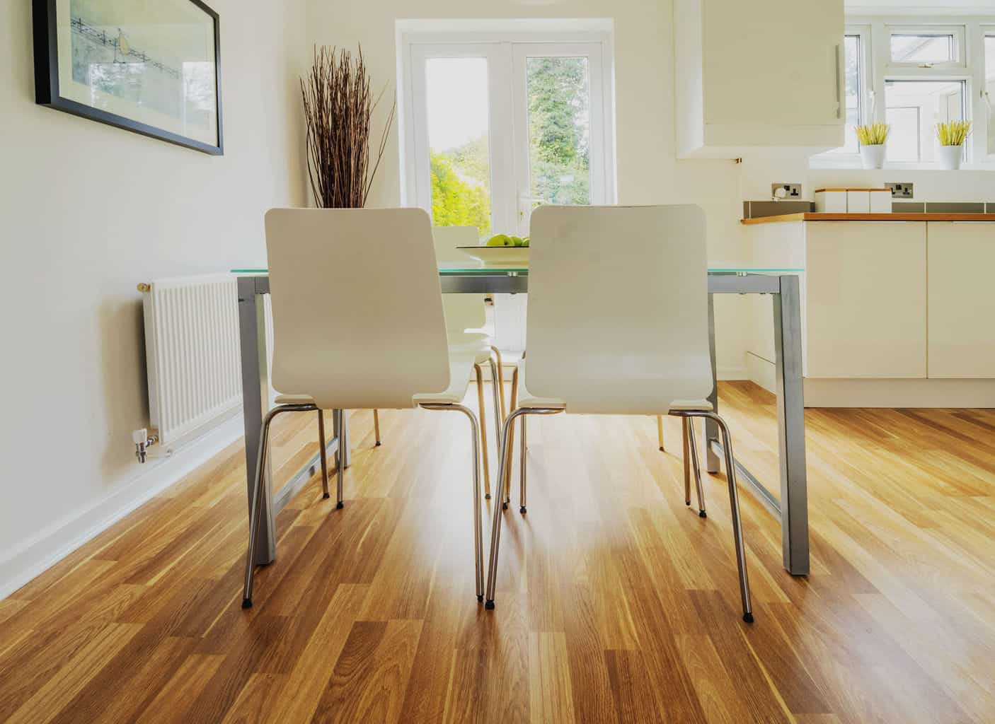 Laminate is able to handle all of these situations without being damaged.  Is it the most durable? Of course not. But for the significantly lower  cost, ...