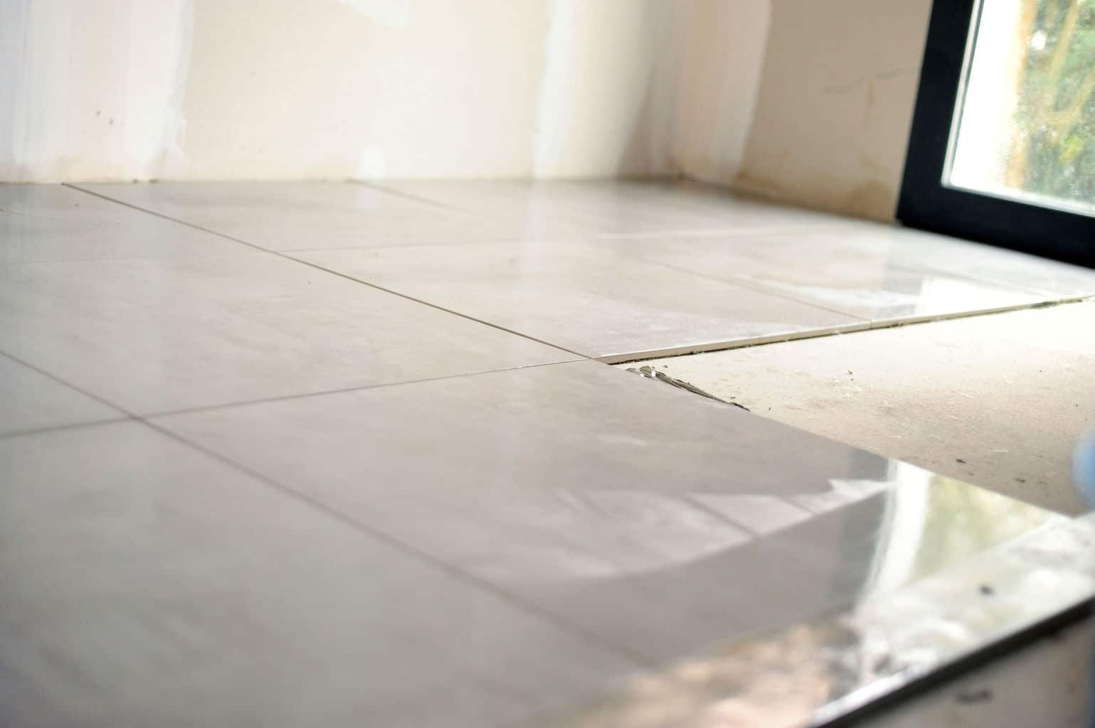 How to install ceramic floor tile on concrete diy tips it may not be the easiest to install but its not that hard either with the proper tools laying a tile floor is a manageable do it yourself project if dailygadgetfo Image collections
